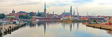 Framed Buildings at the waterfront with church towers in distance, Trave River, Lubeck, Schleswig-Holstein, Germany Print