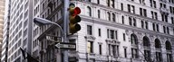 Low angle view of a Red traffic light in front of a building, Wall Street, New York City  Fine Art Print