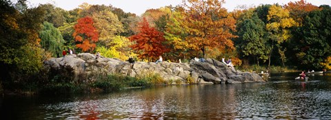 Framed Group of people sitting on rocks, Central Park, Manhattan, New York City, New York, USA Print
