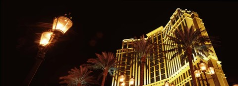 Framed Low angle view of a hotel lit up at night, The Strip, Las Vegas, Nevada, USA Print