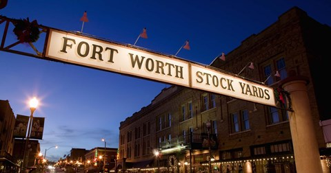 Framed Signboard over a road at dusk, Fort Worth Stockyards, Fort Worth, Texas, USA Print