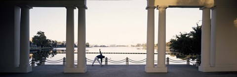 Framed Person stretching near colonnade, Lake Merritt, Oakland, Alameda County, California, USA Print