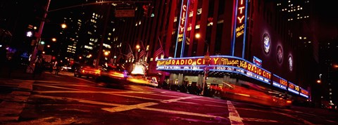Framed Low angle view of buildings at night, Radio City Music Hall, Rockefeller Center, Manhattan, New York City, New York State, USA Print