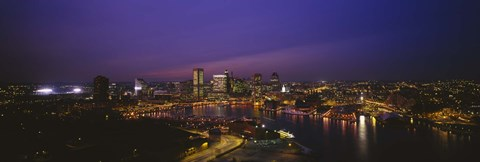 Framed Aerial view of a city lit up at dusk, Baltimore, Maryland, USA Print