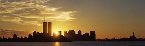 Framed Manhattan skyline and a statue at sunrise, Statue Of Liberty, New York City, New York State, USA Print