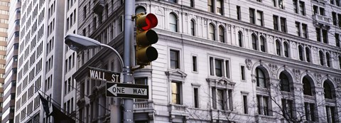 Framed Low angle view of a Red traffic light in front of a building, Wall Street, New York City Print