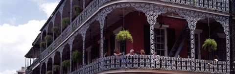 Framed People sitting in a balcony, French Quarter, New Orleans, Louisiana, USA Print