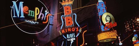 Framed Low angle view of neon signs lit up at night, Beale Street, Memphis, Tennessee, USA Print