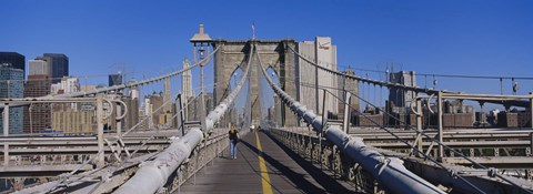 Framed Rear view of a woman walking on a bridge, Brooklyn Bridge, Manhattan, New York City, New York State, USA Print