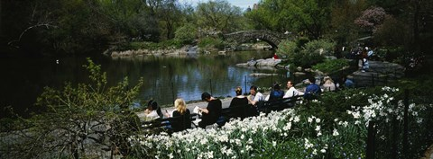 Framed Group of people sitting on benches near a pond, Central Park, Manhattan, New York City, New York State, USA Print