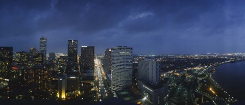 Framed High angle view of buildings in a city lit up at night, New Orleans, Louisiana, USA Print