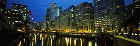 Framed Low angle view of buildings lit up at night, Chicago River, Chicago, Illinois, USA Print