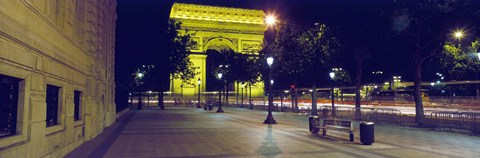 Framed France, Paris, Arc de Triomphe lit up at night Print