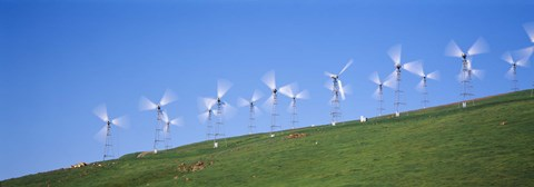 Framed Low angle view of wind turbines on a hill, Altamont Pass, California, USA Print