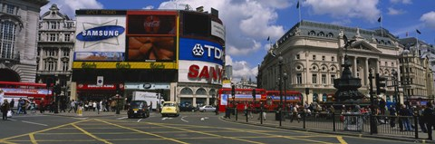 Framed Commercial signs on buildings, Piccadilly Circus, London, England Print