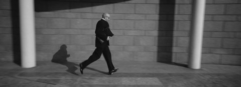 Framed Side Profile Of A Businessman Running With A Briefcase, Germany Print
