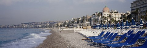 Framed Empty lounge chairs on the beach, Nice, French Riviera, France Print