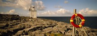 Lighthouse on a landscape, Blackhead Lighthouse, The Burren, County Clare, Republic Of Ireland Art