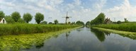 Traditional windmill along with a canal, Damme, Belgium Art