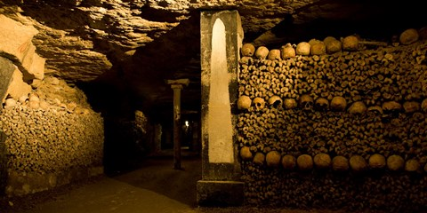 Framed Stacked bones in catacombs, Paris, Ile-de-France, France Print