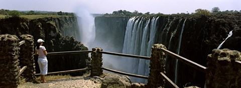 Framed Woman looking at the Victoria Falls from a viewing point, Zambia Print