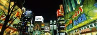 Low angle view of buildings lit up at night, Shinjuku Ward, Tokyo Prefecture, Kanto Region, Japan  Fine Art Print
