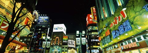Framed Low angle view of buildings lit up at night, Shinjuku Ward, Tokyo Prefecture, Kanto Region, Japan Print