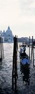 Gondolier in a gondola with a cathedral in the background, Santa Maria Della Salute, Venice, Veneto, Italy Art