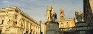 Low angle view of a statues in front of a building, Piazza Del Campidoglio, Palazzo Senatorio, Rome, Italy Art