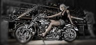 Female model with a motorcycle in a workshop Art