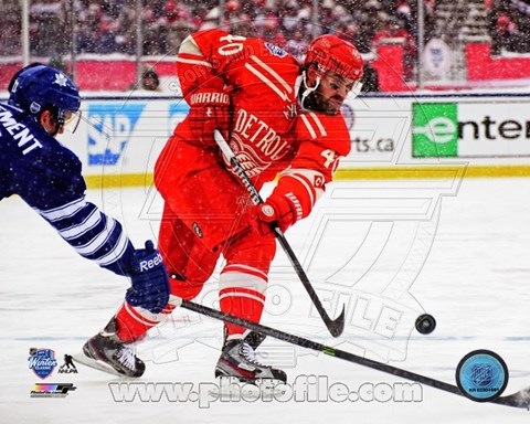 Framed Henrik Zetterberg on ice 2014 NHL Winter Classic Print