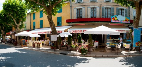 Framed Restaurants during lunch hour along the Rue Du Marche, Riez, Alpes-de-Haute-Provence, Provence-Alpes-Cote d'Azur, France Print