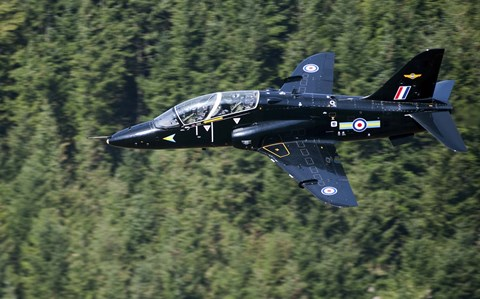 Framed Hawk T1 trainer aircraft of the Royal Air Force flying over a forest in North Wales Print