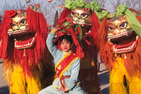 Framed Girl Playing Lion Dance for Chinese New Year, Beijing, China Print