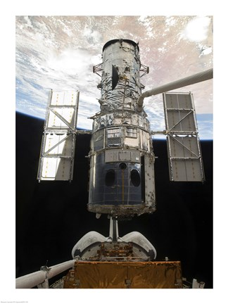 Framed Space Shuttle Atlantis' arm lifts the Hubble Space Telescope from the cargo bay Print