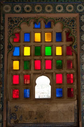 Framed Brightly colored glass window, City Palace, Udaipur, Rajasthan, India. Print