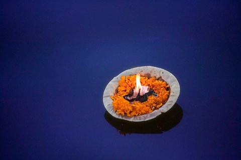 Framed Flower candle in the Ganges River, Varanasi, India Print