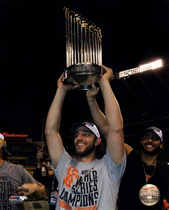 Framed Madison Bumgarner with the World Series Championship Trophy Game 7 of the 2014 World Series Print