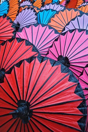 Framed Pattern of newly assembled decorative umbrellas drying in sun, Umbrella Making Center, Bo Sang, near Chiang Mai, Thailand. Print