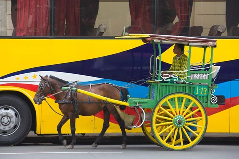 Framed Horse cart walk by colorfully painted bus, Manila, Philippines Print