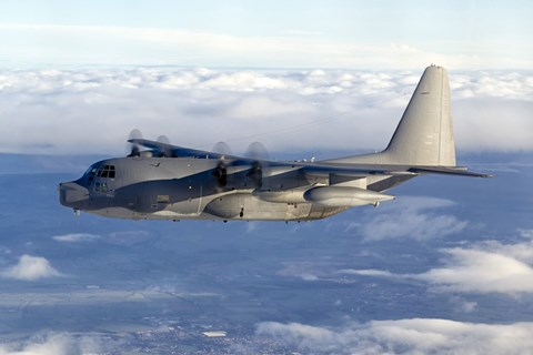 Framed MC-130P Combat Shadow Soars Above the Clouds Print