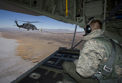 Framed Loadmaster on an HC-130 Watches a HH-60G Pave Hawk Refuel Print