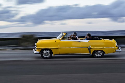 Framed 1950's era car in motion along the Malecon or seawall, Havana, Cuba Print