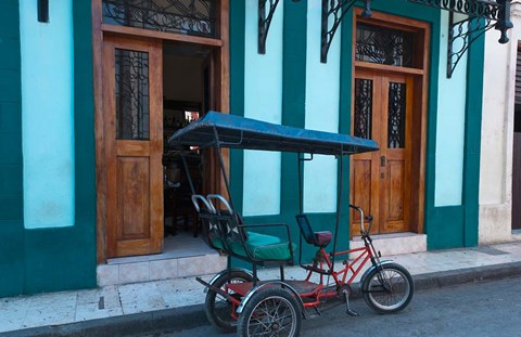 Framed Cuba, Camaquey, bike carriage and buildings Print