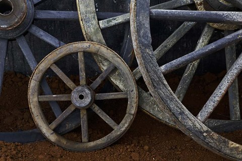 Framed Rustic wagon wheels on movie set, Cuba Print