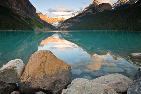 Framed Rocky Mountains and boulders reflected in Lake Louise, Banff National Park, Alberta, Canada Print