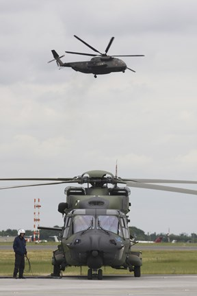 Framed German Army NH90 and its Predecessor, the CH-53 Sea Stallion Print