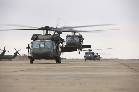 Framed UH-60 Black Hawks taxis out for a mission over northern Iraq Print