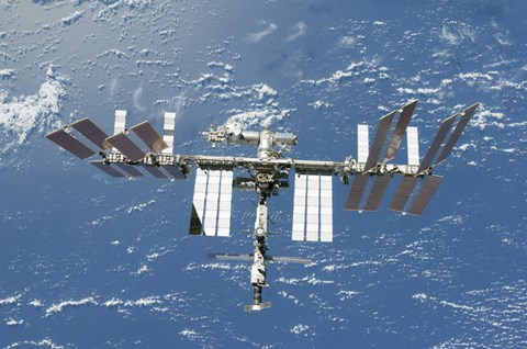 Framed International Space Station Backdropped by a Blue and White Part of Earth Print