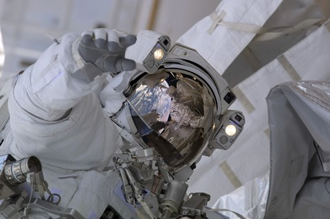 Framed Astronaut Participates in a Session of Extravehicular Activity Print